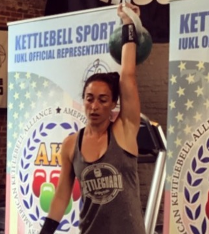 Jessica DiBiase competes at Bells and Bites Kettlebell Sport Competition